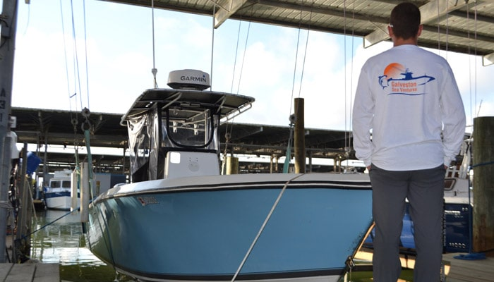 Captain Shane Cantrell standing in front of his boat