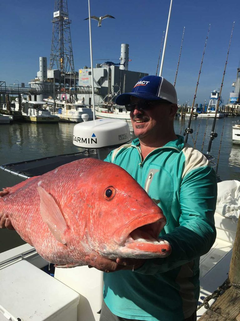Male angler holds large Galveston Red Snapper